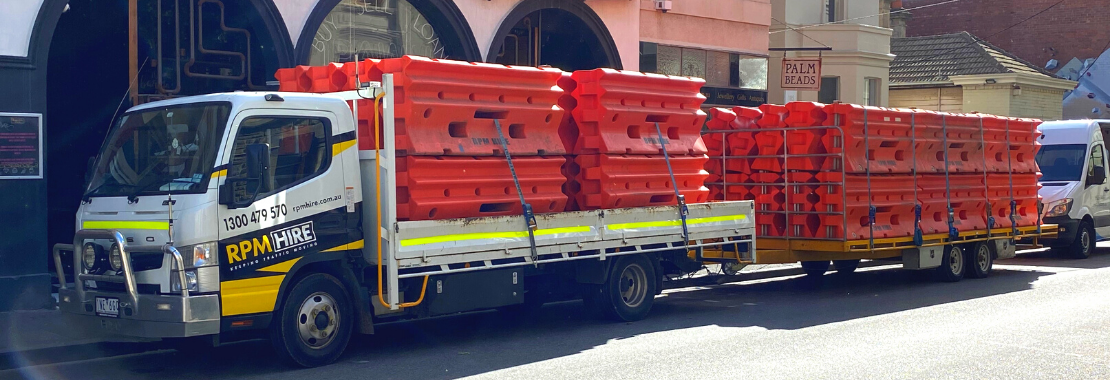 RPM Hire truck with Water Filled Barriers